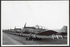 A Long Line of Fokker S11 Instructors on the Ground. 7 inch x 5 inch Photograph