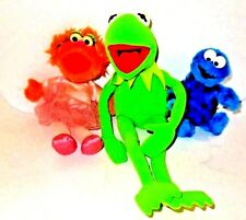 Kermit the Frog Petunia and Cookie Monster from Sesame Street and Muppets