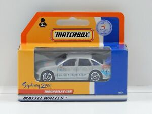 """1:64 Holden Commodore - """"Sydney 2000 Olympics Torch Relay Car"""" Matchbox 96534"""