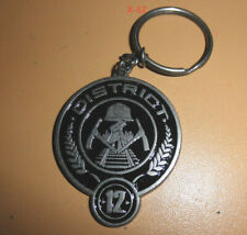 THE HUNGER GAMES movie DISTRICT 12 metal KEYCHAIN Key Ring Neca Toy Mockingjay