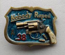 """Vintage 1982 """"Nobody Raped A 38"""" Pistol Belt Buckle by Great American Buckle Co"""