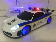 POLICE FERRARI RADIO REMOTE CONTROL CAR POLICE SIRENS & FLASHING LIGHTS BOXED UK