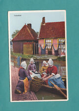 Volendam Holland Women in Row Boat With Baskets Vintage Postcard Card OLD