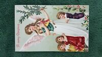 1908 CHRISTMAS POSTCARD ANGEL TREE 3 GIRLS DOLLS TOYS GIFTS