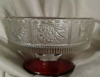 Vintage clear pressed glass footed dish with cranberry color on base