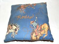 Vintage Rodeo Cowboys on Bucking Broncos Blue Background Pillow 14X14
