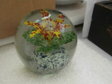 LARGE AND HEAVY  PAPERWEIGHT MOTTLED BLUE BASE  RED AND YELLOW FLOWER  NO MAKER