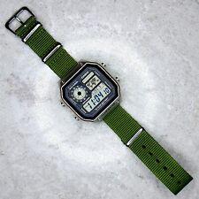 Iluminador Casio Hora Mundial Reloj con banda de color verde oliva la OTAN, AE-1200WHD -1 AVEF