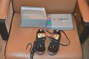 chaussure neuve babybotte  24 black avec revers or superbe