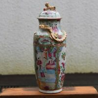 An antique canton rose lidded vase with gold gilded dragon decoration