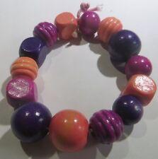 Bracelet exotique avec grosses perles de bois peints