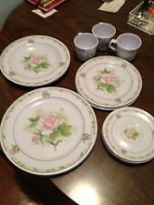 Set of plastic cups and plates made in China -- rose design. 3 cups, 4 saucers,