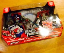 Transformers 2007 And 1984 Optimus Prime Leader For The Ages 2 Pack Giftset