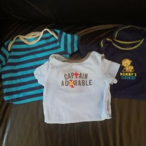 3 Carters Child of Mine short sleeve rompers Pre-owned size 6-12 months