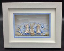 Cute Raised effect Rabbits on a Pretty Background Of Blue Shades.