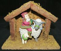Santa and Donkey in a Manger Figurine