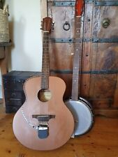 Dallas (?) 5 string long neck resonator banjo (guitar for scale only)