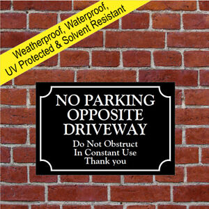 No parking opposite driveway do not obstruct in costant use sign notice 9683