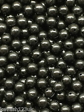 100 x Black 6mm Rig Beads + 20 x 8mm Free Glow in the Dark Orange & Green Beads