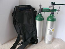 Portable Oxygen Tank W/ New Carrying Case and Used Regulator & 2 Used Tanks.