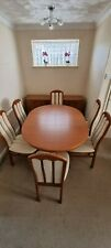 Teak Dining table and 6 chairs (Extending) Great unmarked condition.