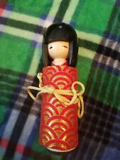 Wooden Chinese Doll With Wrap That Ties. Photo Holder