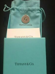 "Tiffany and Co. Letter ""G"" Disc Charm (with Tiffany box and pouch)"