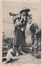 GUATEMALA, 00-10s ; Indigena cargador & dog