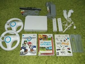 WII BUNDLE  + WII SPORTS + MARIO KART +WII PLAY + 2 REMOTE WII