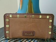 The Sak brown leather Bi-Fold Clutch card Wallet w/gold tone stud design.NWOT