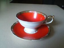 ROYAL BAYREUTH ORANGE IN GOLD TRIM FANCY HANDLE TEA CUP AND SAUCER