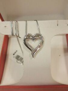 Two Hearts Forever One Sterling Silver 1/4 Carat T.W. Diamond Heart Pendant $300