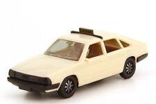 1:87 Audi 100 GL 5E Avant Typ 43 C2 Taxi, IA beige - herpa 4004