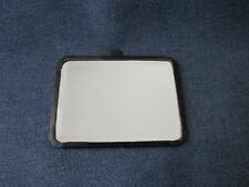 Vintage beveled mirror lined in genuine black leather with ring on top for purse