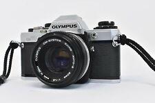 Olympus OM-10 35mm SLR Film Camera with Zuiko 50mm f/1.8 Lens & Case Bundle