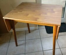 Extending drop leaf  dining table
