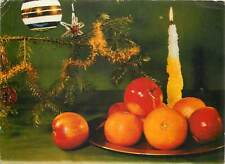 Postcard christmas tree with red apples and oranges