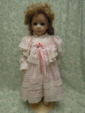 """C&D: Porcelain reproduction doll; 19"""" tall; in pink; imprinted Vs cp-759"""