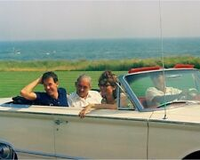 President John F. Kennedy drives a car with Jackie and friends New 8x10 Photo