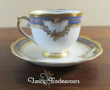 Roslyn China England Porcelain Cobalt Blue and Gold Footed Cup and Saucer