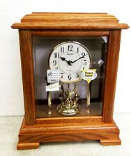 SEIKO MANTEL CLOCK IN WOODEN CASE WITH  3 ROTATING SWAROVSKI CRYSTALS QXW230BLH