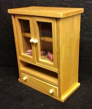 Doll's house furniture linen cupboard.