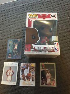 4 x Michael Jordan NBA basketball cards. 1 x Michael Jordan pop vinyl. WOW