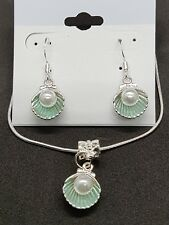 Imitation pearl in a green alloy shell stirling silver necklace and earring set