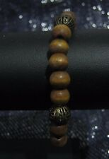 Fantastic wooden beaded elasticated bracelet with bronze spacer beads
