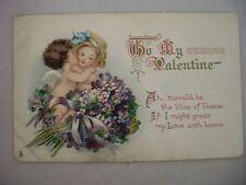 Vintage Tuck'S Valentine'S Postcard Cupid Kissing Girls Cheek In Flowers W/ Poem