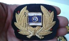 A Nice Original Dennison Shipping Gold EMBROIDERED CAP BADGE