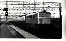 DC60. Photograph of an electric locomotive train passing Nuneaton Station. 1976