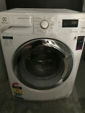 White Electrolux Front-Loading Washing Machine - Model EWF12753