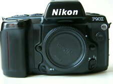 Nikon F90x body only + body cap and MB10 battery pack- film tested.
